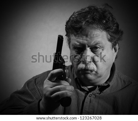 middle aged man with a revolver
