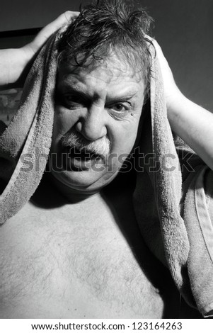 middle-aged man with a towel out of the bathroom