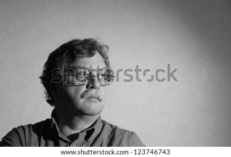 middle aged man with glasses and a plaid shirt