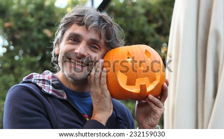 middle aged Man with Halloween pumpkin - stock photo