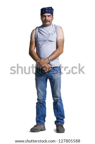 Middle aged man with head scarf - stock photo