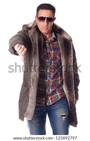 middle aged man with winter clothing makes negative gesture