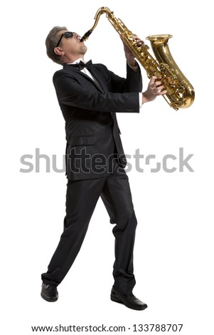 Middle-aged manplaying on saxophone isolated on background