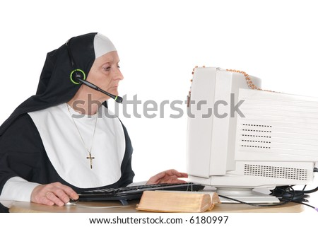 Middle aged nun, sister on computer, connection with god.  Headset with microphone on head