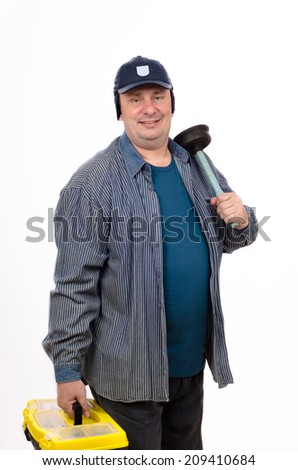 Middle-aged plumber holding plunger in left hand and tools box in right