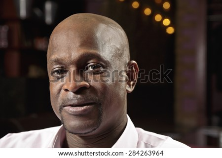 Middle-aged positive guy in pink shirt closeup portrait - stock photo
