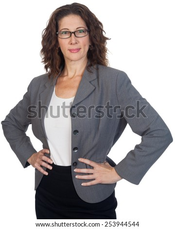 Middle aged professional woman, with her arms akimbo. - stock photo