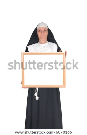 Middle aged smiling nun with advertising board
