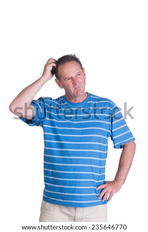 Middle aged white man in a blue striped shirt thinking or scratching his head  - stock photo