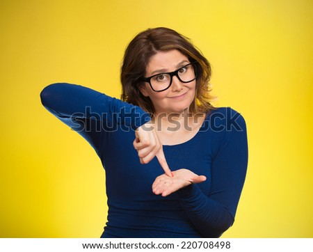 middle aged woman asking to pay money back, finger on palm gesture, isolated yellow background. Human face expression, emotions, feeling, body language non verbal communication. Financial debt concept - stock photo