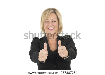 Middle aged woman doing thumbs up with both hands against a white background - stock photo