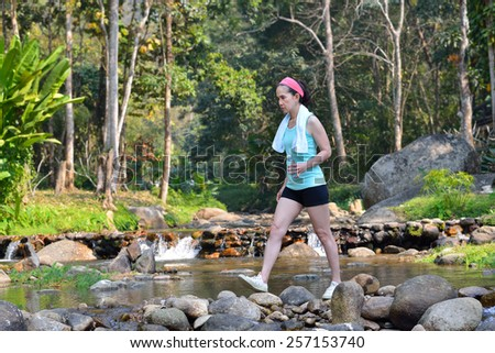 Middle aged woman exercise by walking in the park - stock photo