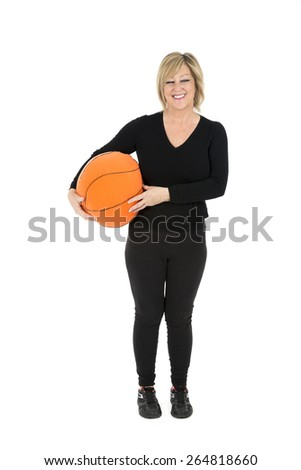 Middle aged woman holding a basketball ball against a white background - stock photo