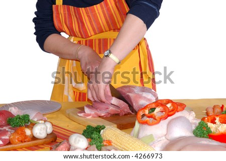 Middle aged woman, housewife  cutting meat for freezing. Preservation, nutrition, food  concept