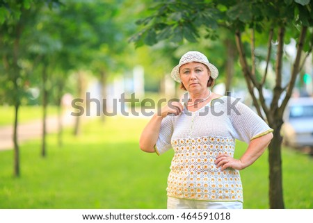middle aged woman  in a knitted hat outdoors. Mama