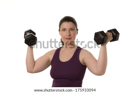 Middle aged woman in muscleshirt with two dumbbells, isolated