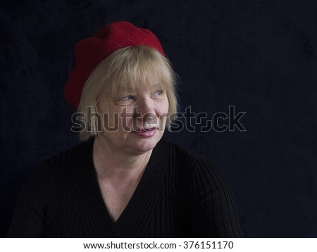 middle aged woman in red beret - stock photo