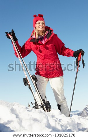 Middle Aged Woman On Ski Holiday In Mountains - stock photo