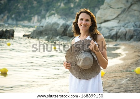 Middle Aged Woman Portrait on the beach - stock photo