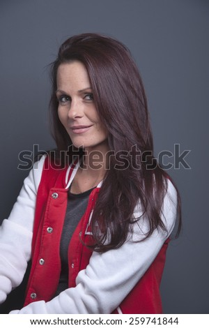 Middle aged woman posing for a studio portrait - stock photo