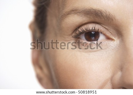 Middle-aged woman's eye - stock photo