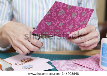 Middle Aged Woman Scrapbooking At Home