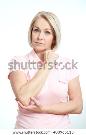 Middle-aged woman serious look at the camera isolated on white background