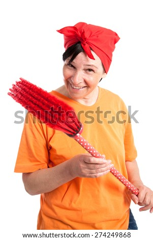 Middle aged woman smiling with dotted broom isolated on white - stock photo