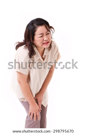 middle aged woman suffering from knee pain, joint injury or arthritis - stock photo