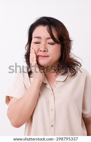 middle aged woman suffering from toothache