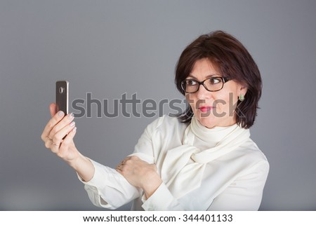 Middle aged woman taking a selfie
