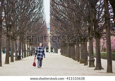 Middle aged woman walking in Paris, France