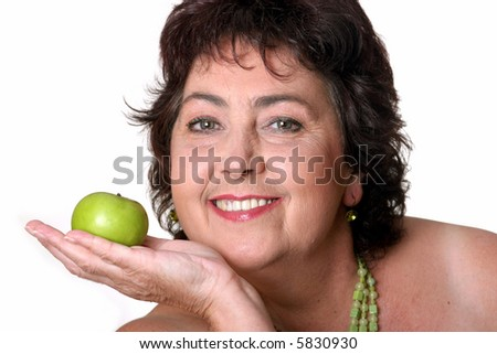 middle-aged woman with green apple - stock photo
