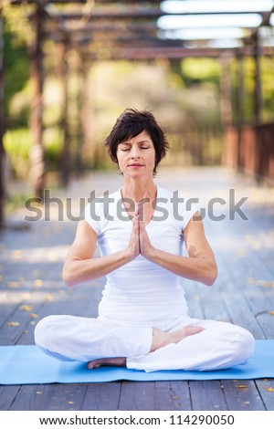 middle aged woman yoga meditation - stock photo