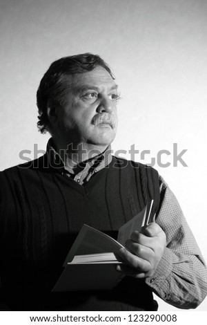 middle ager man stay with a book - stock photo