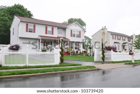 Middle Class Suburban High Ranch Home Rainy Residential  Neighborhood overcast day - stock photo
