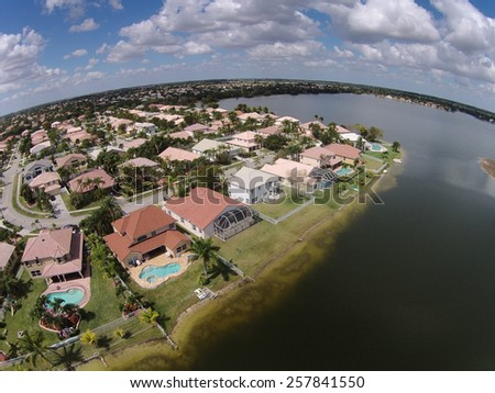 Middle class waterfront homes in Florida seen from above