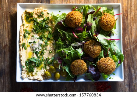 Middle East cuisine: a plate of delicious falafels and hummus. Vegetarian fare. - stock photo