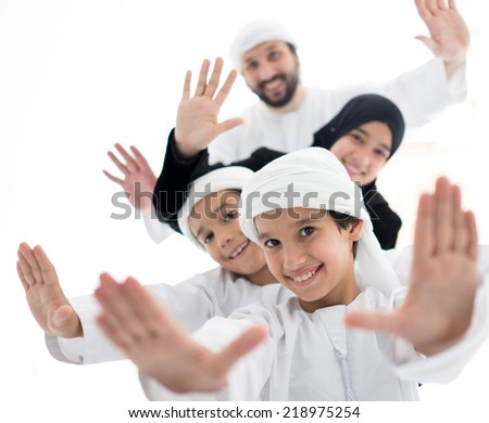 Middle eastern family at home - stock photo