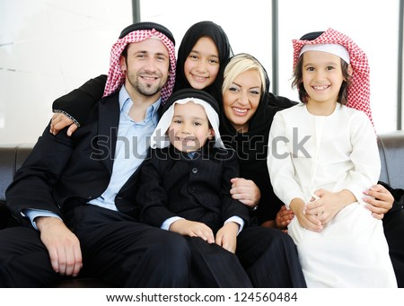 Middle eastern family, father and mother with kids - stock photo
