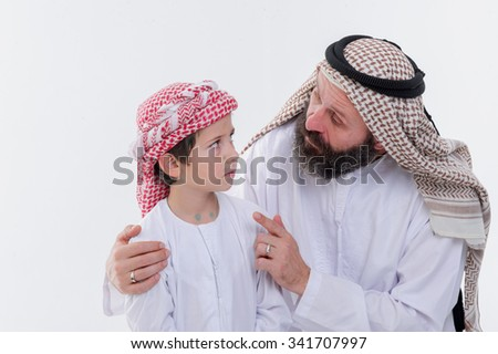 Middle eastern father teaching his son on white background.