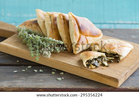 Middle eastern Homemade fatayer stuffed in spinach - stock photo