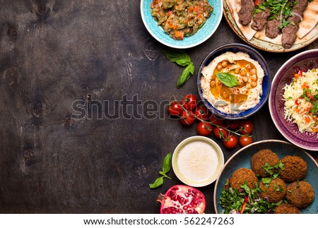 Middle eastern arabic dishes assorted meze imagen de archivo stock middle eastern or arabic dishes and assorted meze on a dark background meat kebab forumfinder Gallery