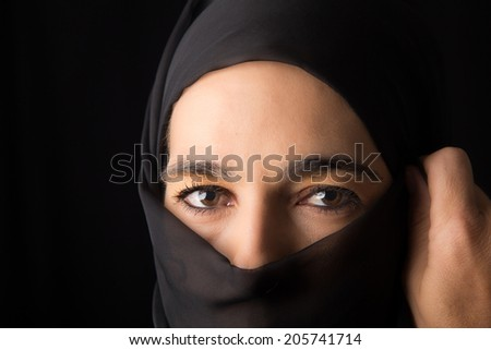 Middle Eastern woman portrait looking sad with a hijab artistic conversion - stock photo