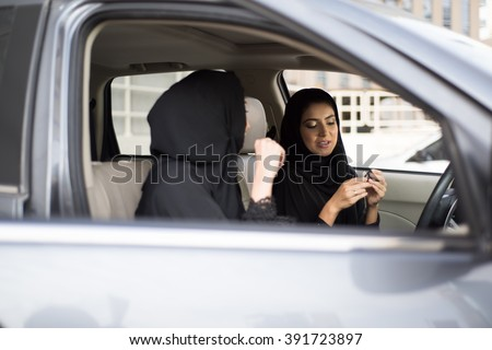 Middle Eastern Women Sitting Inside a Car