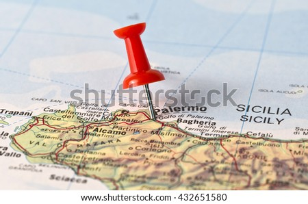Middle of North Pole marked on map with red pushpin. Selective focus on the word North Pole and the pushpin. Pin casts harsh shadow to the right.  - stock photo