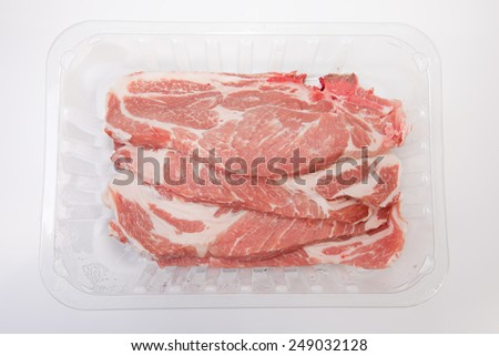 Middle rib chops of pork on the package. Isolated on white - stock photo