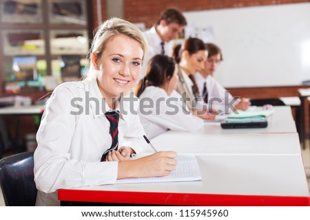 middle school girl student sitting in classroom - stock photo