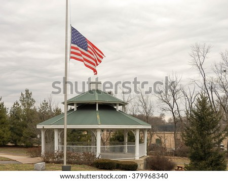 MIDDLE-TOWN, KENTUCKY: February Eighteenth, Two Thousand Sixteen - Middle-town city park with flag and gazebo for residents to enjoy outdoor events all year around, taken on a cloudy winter day.