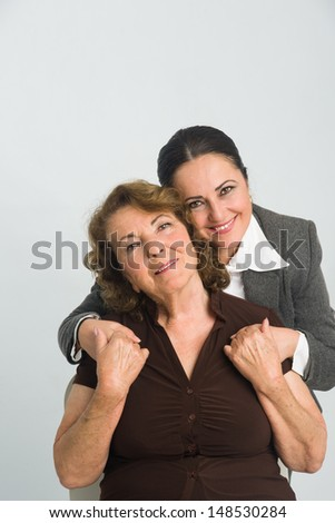 Middleaged woman  and mother are holding their hands - stock photo